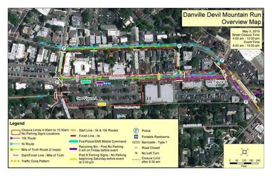 Street view of downtown Danville.  Angle is very high in the air, showing the roads and buildings. A light blue line shows where the 5k runners are going and a purple line shows where the 10k runners are going. In the lower left corner is a key for all of the markings on the map.