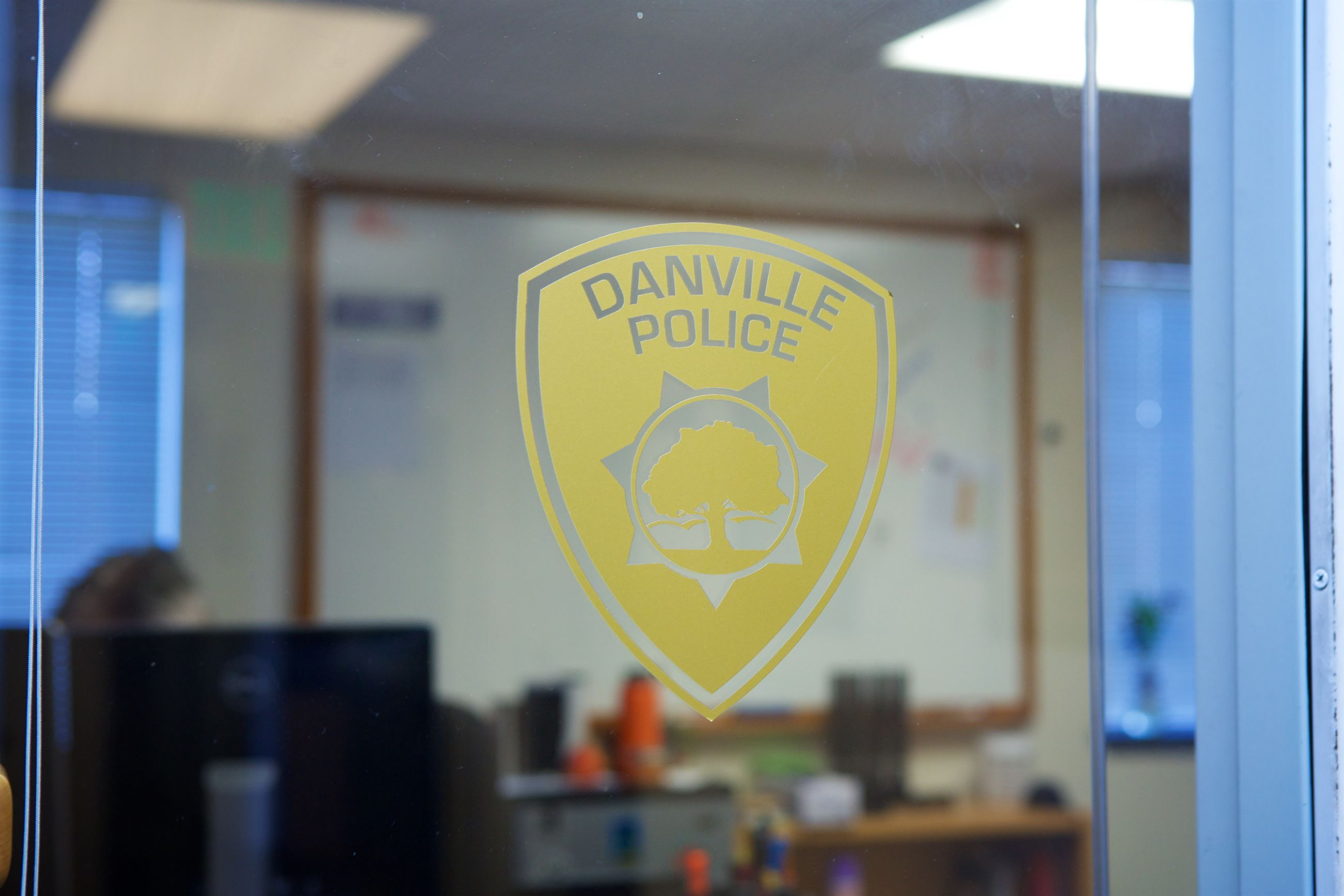 Danville Police Logo Sticker in a Window