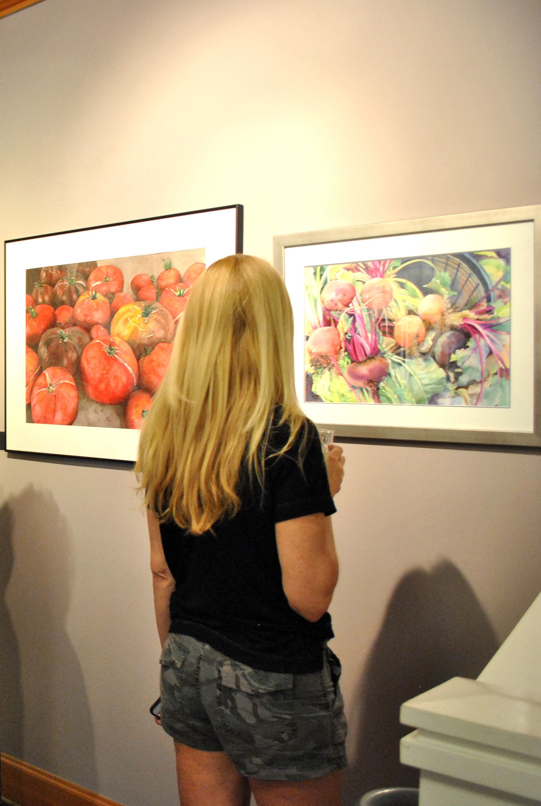 Blonde Woman Looking at Artwork