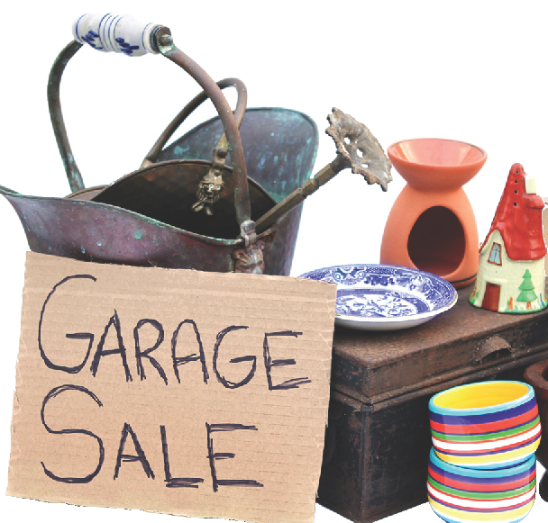Cardboard sign saying garage sale leaning against various items for sale