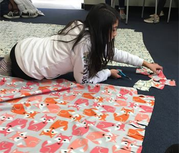 Teen making a blanket at the Danville Teen Center
