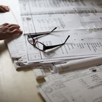 Glasses on paperwork