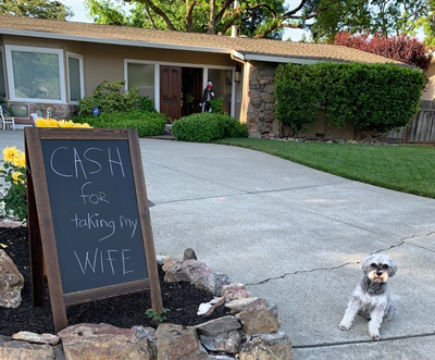 "chalkboard showing ""cash for taking my wife"""
