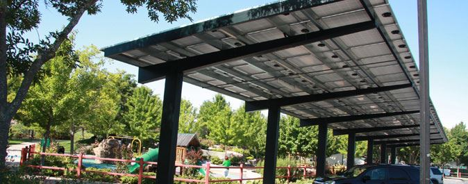 Solar Panel awning with vehicles parked underneath