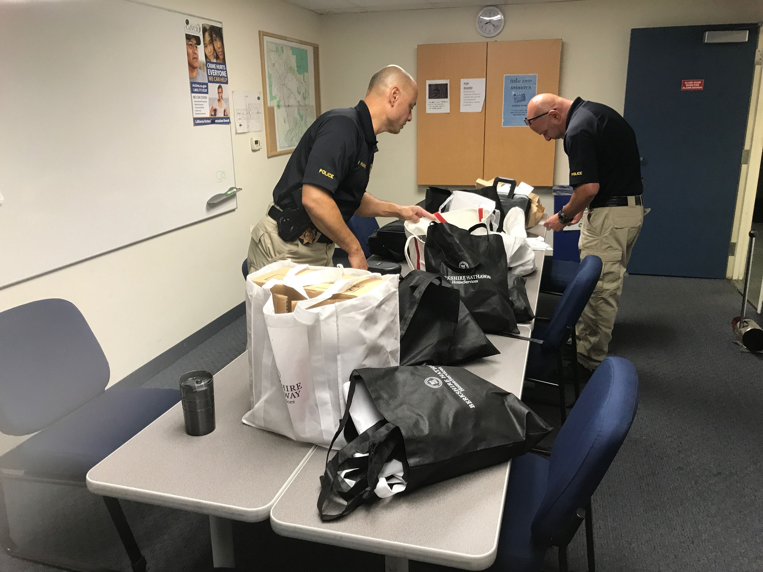 Sergeant Hoekwater and Detective Stapleton pour through mounds of recovered stolen property.